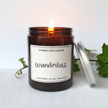 Wanderlust soy amber jar candle.