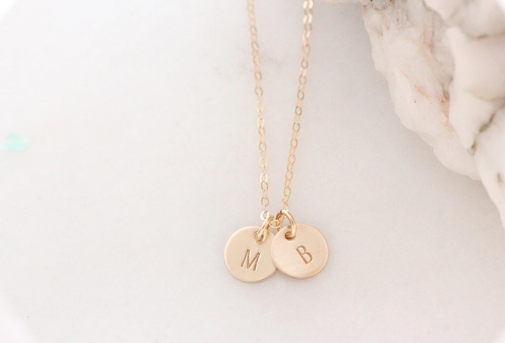 tiny gold disc necklace with initials