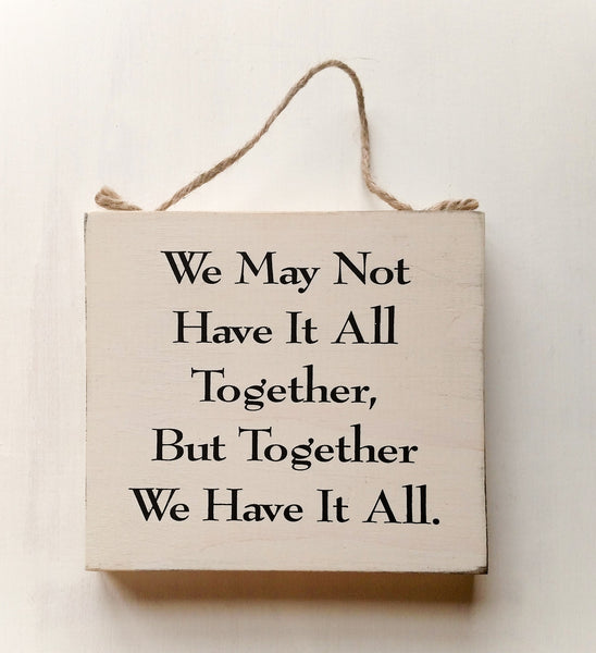 wood sign saying We May Not Have It All Together, But Together We Have It All