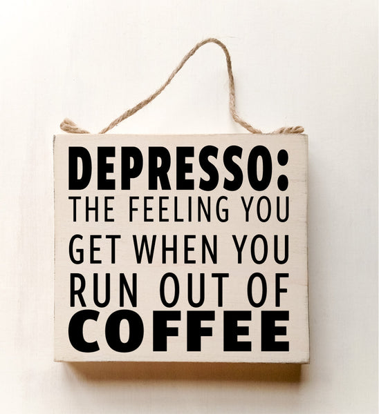 wood sign saying DEPRESSO: That Feeling You Get When You Run Out Of Coffee