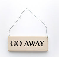 wood sign saying Go Away