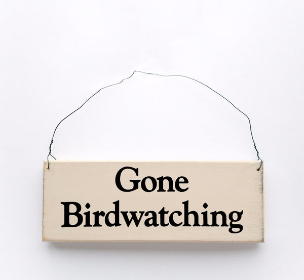 wood sign saying Gone Birdwatching
