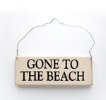 wood sign saying Gone to the Beach