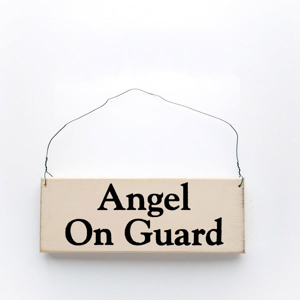 wood sign saying Angel On Guard