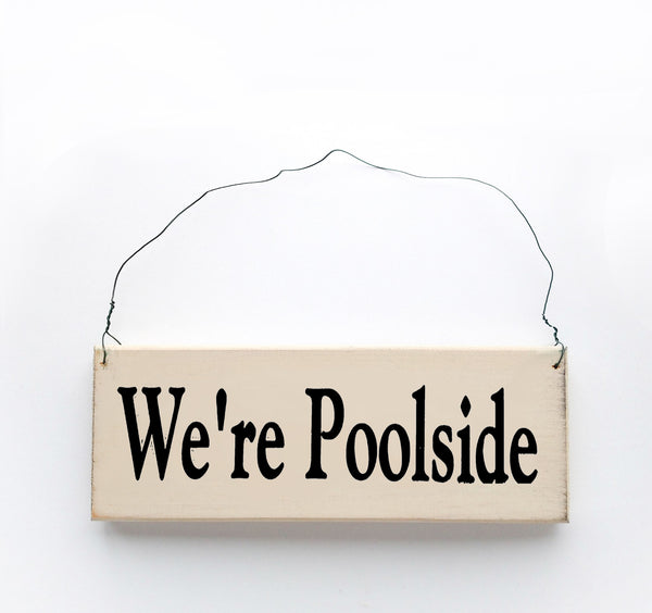 wood sign saying We're Poolside