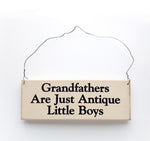 wood sign saying Grandfathers are Just Antique Little Boys