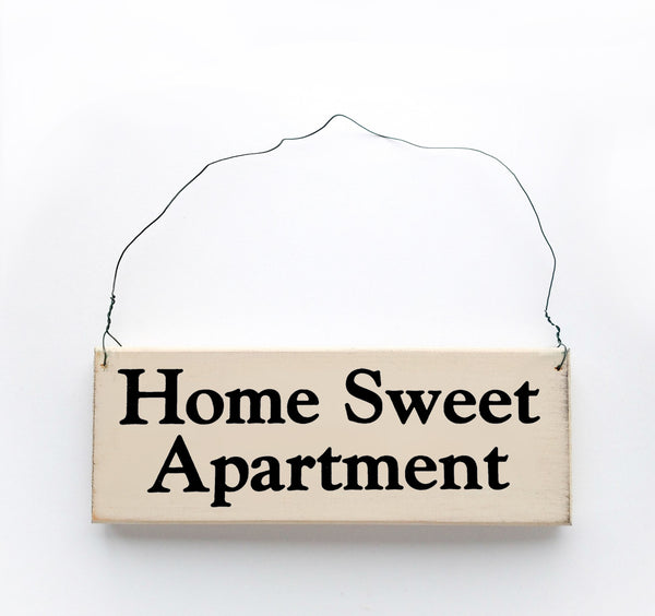 wood sign saying Home Sweet Apartment
