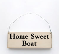 wood sign saying Home Sweet Boat