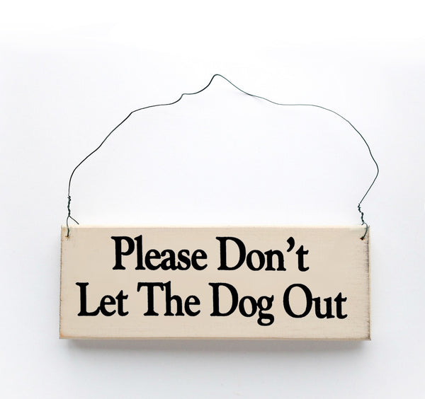 wood sign saying Please Don't Let the Dog Out