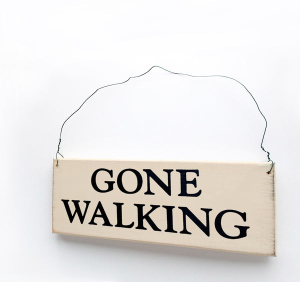 wood sign saying Gone Walking