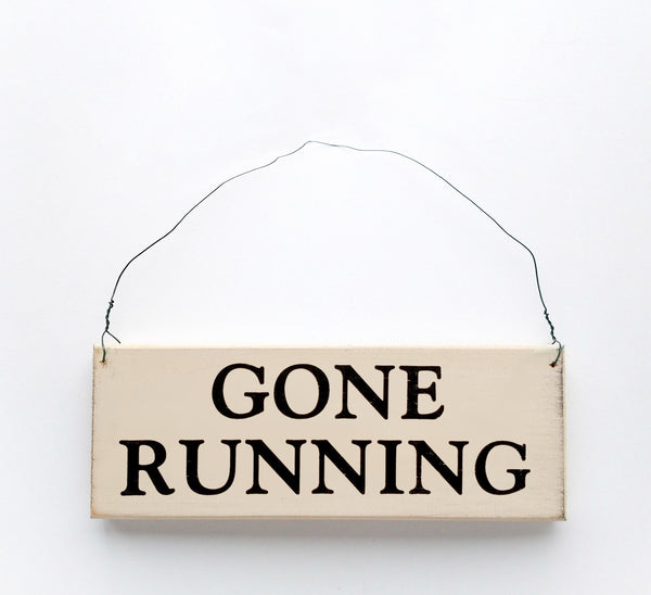 wood sign saying Gone Running