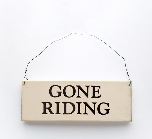 wood sign saying Gone Riding