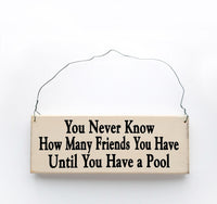 wood sign saying You Never Know How Many Friends You Have Until You Have A Pool
