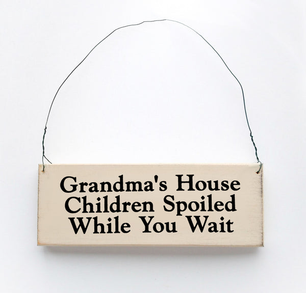 wood sign saying Grandma's House Children Spoiled While You Wait