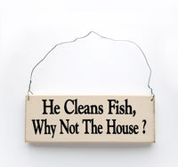 wood sign saying He Cleans Fish, Why Not the House?