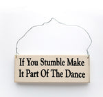 wood sign saying If You Stumble, Make It Part Of The Dance