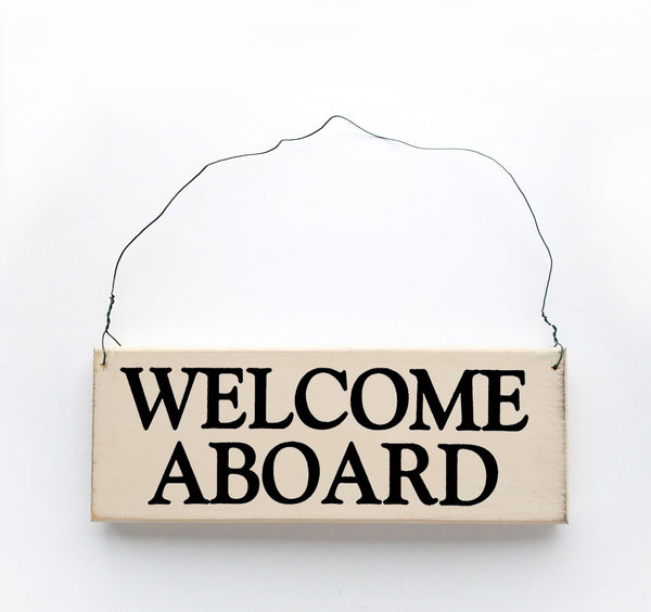 wood sign saying Welcome Aboard