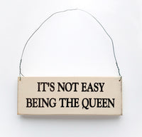 wood sign saying It's Not Easy Being the Queen
