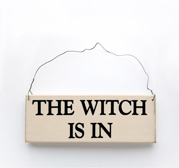 wood sign saying The Witch is In