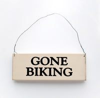 wood sign saying Gone Biking