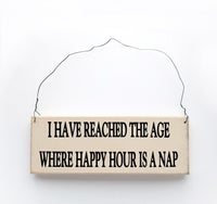 wood sign saying I Have Reached the Age Where happy Hour is a Nap
