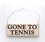 wood sign saying Gone to Tennis