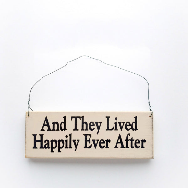 wood sign saying And They Lived Happily Ever After