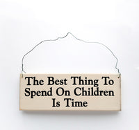 wood sign saying The Best Thing to Spend on Children is Time