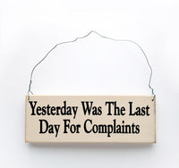 wood sign saying Yesterday Was the Last Day for Complaints