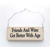 wood sign saying Friends and Wine Get Better With Age