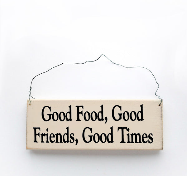 wood sign saying Good Food, Good Friends, Good Times