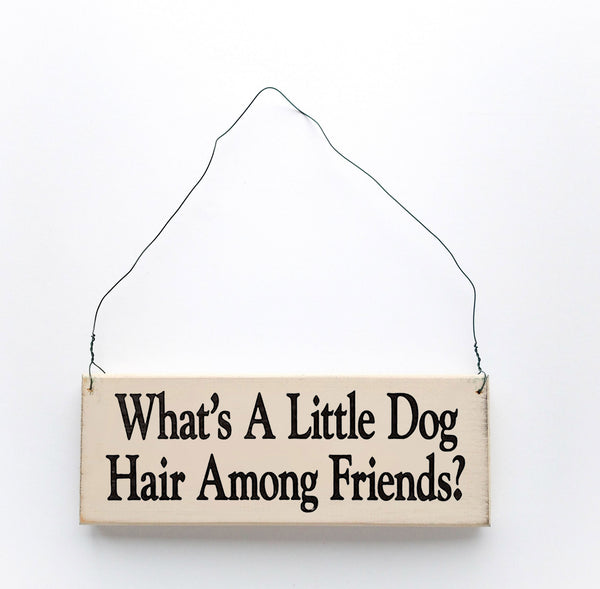 wood sign saying What's a Little Dog Hair Among Friends