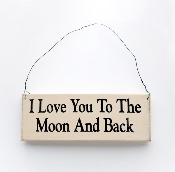 wood sign saying I Love You to the Moon and Back