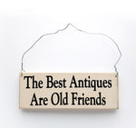 wood sign saying The Best Antiques Are Old Friends