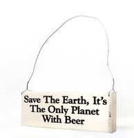 wood sign saying Save the Earth, It's the Only  Planet With Beer