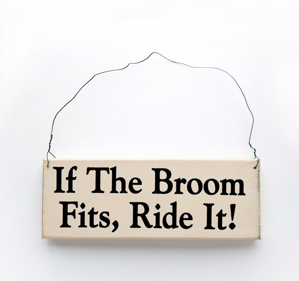 wood sign saying If the Broom Fits, Ride It