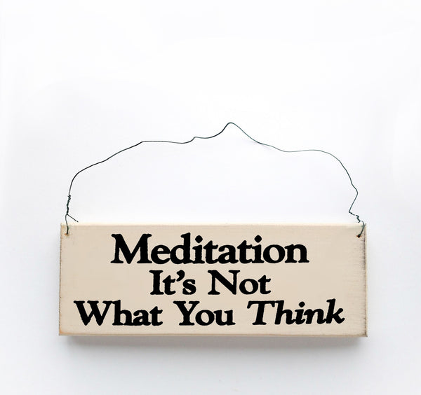 wood sign saying Meditation It's Not What You Think