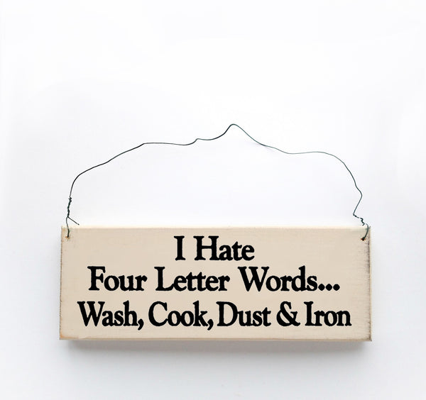 wood sign saying I Hate Four Letter Words...Wash, Cook, Dust & Iron