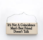 wood sign saying It's Not a Coincidence Man's Best Friend Doesn't Talk