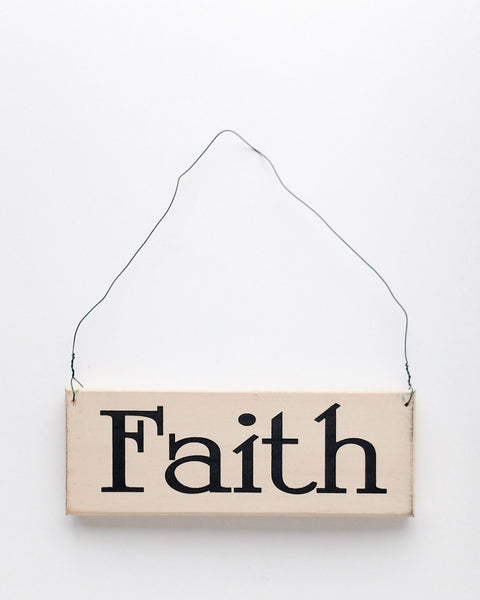wood sign saying Faith