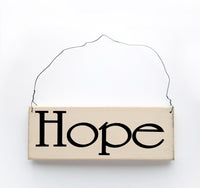 wood sign saying Hope