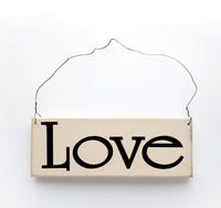 wood sign saying Love