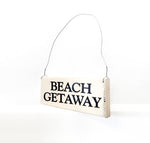 wood sign saying Beach Getaway