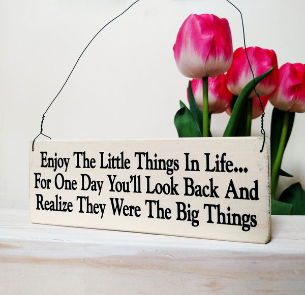 wood sign saying Enjoy the Little Things in Life: For One Day You'll Look Back And Realize They Were The Big Things