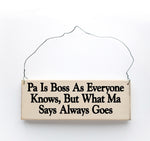 wood sign saying Pa is Boss, As Everyone Knows, But What Ma Says Goes