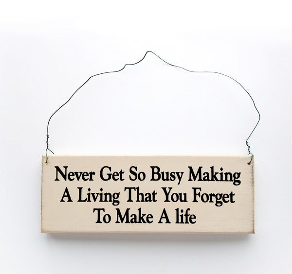 wood sign saying Never Get So Busy Making A Living That You Forget To Make A Life