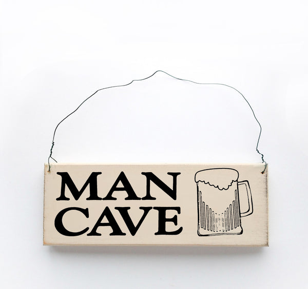 wood sign saying Man Cave