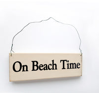 wood sign saying On Beach Time