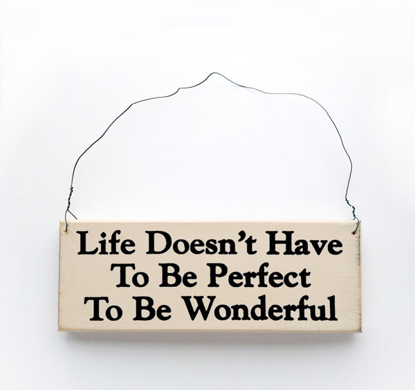 wood sign saying Life Doesn't Have to be Perfect To be Wonderful