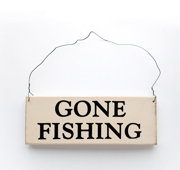 wood sign saying Gone Fishing